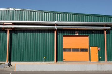 Factory building with aluminum cladding