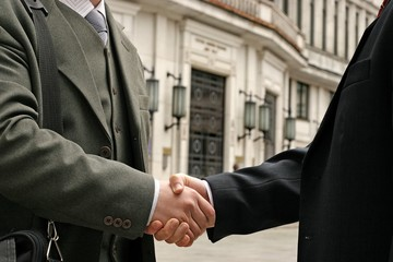 handshake on a street