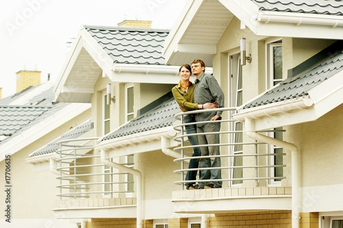 couple on balcony of one-family house