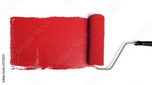 Leinwanddruck Bild Paint Roller With Red Paint