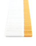 Row of cigarettes isolated on white