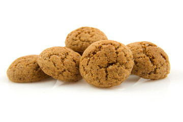 pepernoten (ginger nuts) in closeup over white background