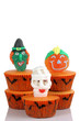Scary cup cakes on white background