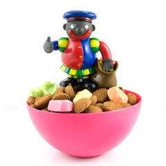 Black Piet on pink bowl with pepernoten
