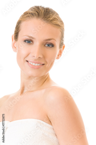 Portrait of young woman in towel terry, isolated on white