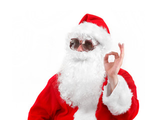 santa claus in shades showing an ok sign