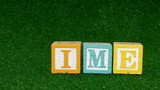 Alphabet blocks on grass background GAME TIME- HD