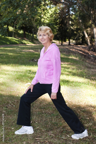 Active senior woman exercising outdoors