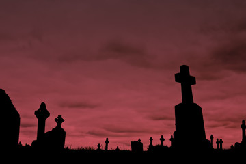 Crosses silhouettes against a cloudy sky