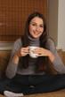 a woman with a teacup