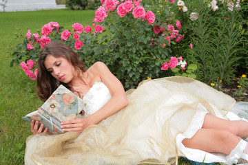 princess with book in hand in the flowers
