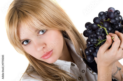 Portrait of the girl with grapes cluster. Isolated