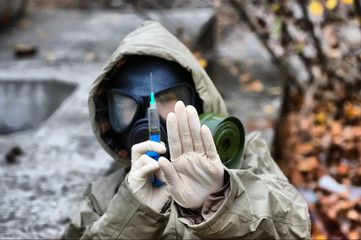 person in gas mask with syringe
