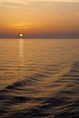 Orange Sunlight Reflected Across Calm Sea