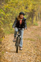 Girl riding a bike.
