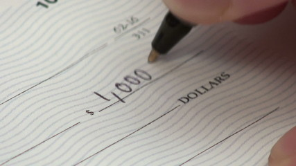 Writing check for one thousand dollars - HD