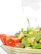 Salad With Tomato Wedges And Ice Water