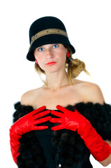 beautiful girl in hat and red gloves