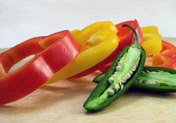 sliced peppers on cutting board