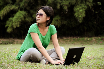 Girl with sunglasses and a computer