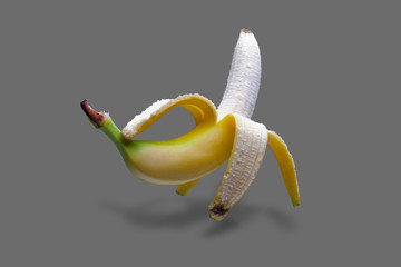 Nice floating banana on grey background with shadow