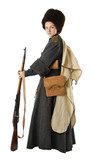 Woman in vintage costume of Russian Cossack with a rifle.