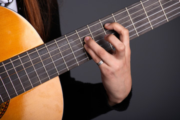 Close up of female guitarist hand playing guitar