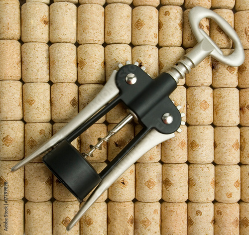Corkscrew on wine corks background