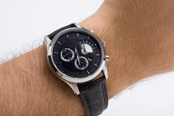 Watch on a hand