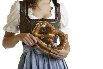 Bavarian girl in Dirndl with Oktoberfest Pretzel - Wiesn Brezn