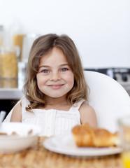 Little girl having breakfast