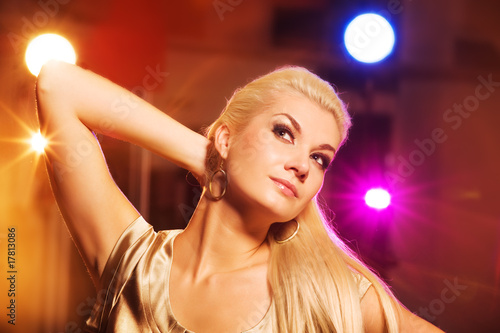 Attractive blond woman in the night club