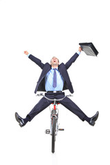 Happy young businessman on a bicycle isolated against white