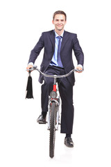 Young businessman on a bicycle isolated against white background