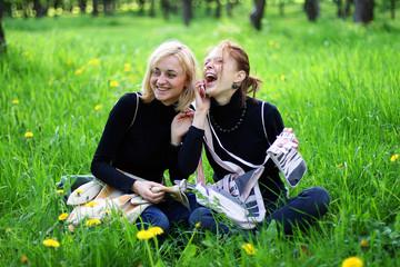 girls in park talking by phones