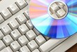 Bright disc cd/dvd on computer keyboard.