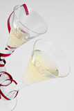 Two  champagne glasses  with  providing poster
