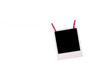 polaroid photo with clothespins