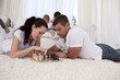 Couple playing chess on floor in living-room
