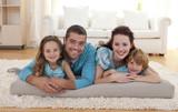 Fototapety Family on floor in living-room