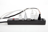 over loaded surge protector poster