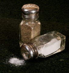 Spilled salt with pepper shaker