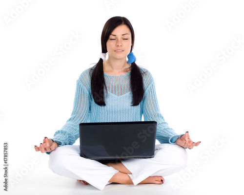 Girl doing yoga with laptop