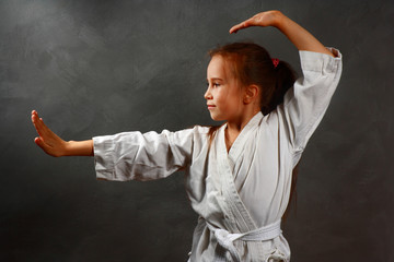 young girl in a white kimono, karate