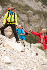happy female hiking guide with senior hikers