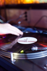 dj is scratching on a turntable