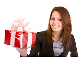 Girl in business suit with christmas red box. Isolated.