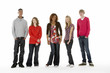 Full Length Studio Portrait Of Five Teenage Friends