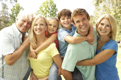 Mother And Father Giving Children Piggy Back With Grandparents