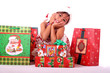 cute asian child with christmas gifts